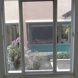 Cửa lưới chống muỗi dạng lùa màu trắng sứ HM95